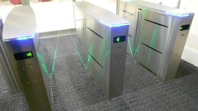 Glass speedgate turnstiles with indicator lights