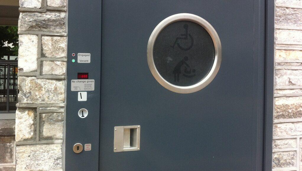 Coin operated public toilet door