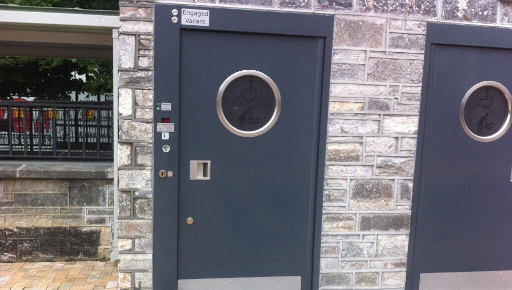 Coin operated public toilet doors