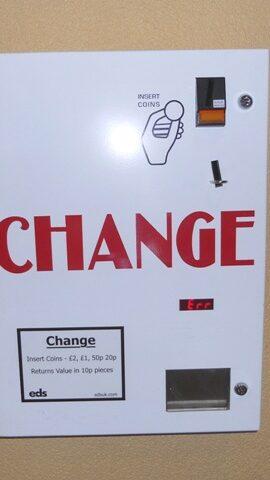White painted change machine
