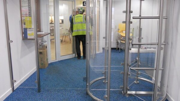 Glass entrance turnstiles with wide pedestrian access gate