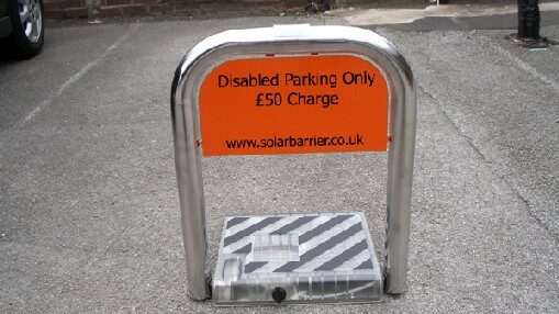 Solar powered parking bay barrier with personalised plate