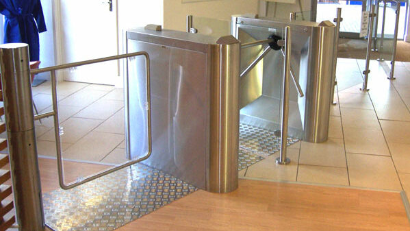 Rotary turnstiles with wide glass access gate