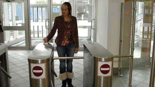 Rotary half height turnstiles in use