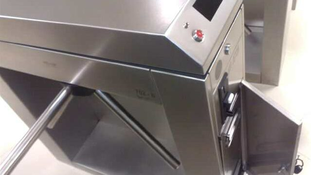 Coin access panel on coin operated turnstile