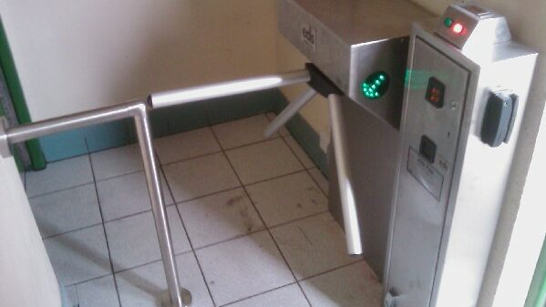 Half height turnstile with coin access control