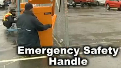 Man operating the emergency safety handle on a rising fence traffic barrier