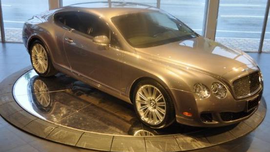 Bentley on car turntable in showroom