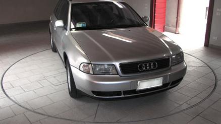 Audi on car turntable in car park