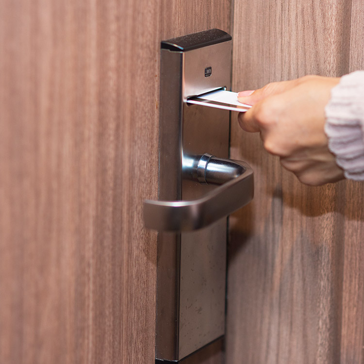 Person using a swipe card to enter a hotel room