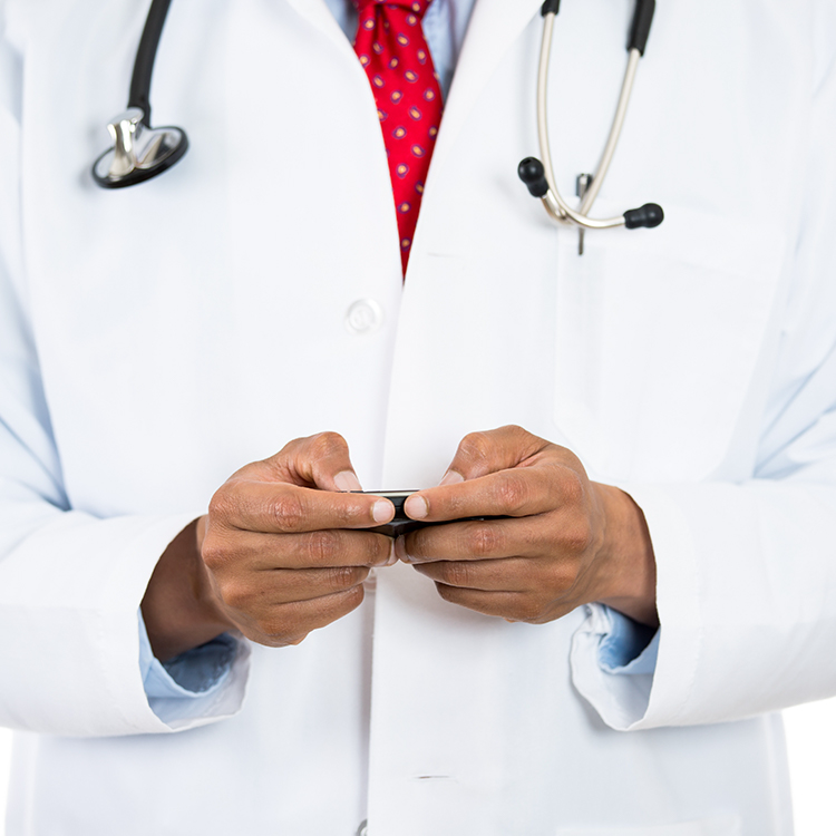 Photo of doctor using paging device
