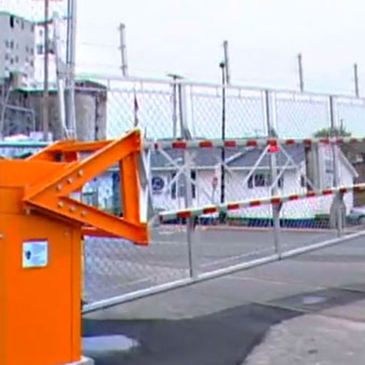 Installation of an automatic rising fence traffic barrier across a road
