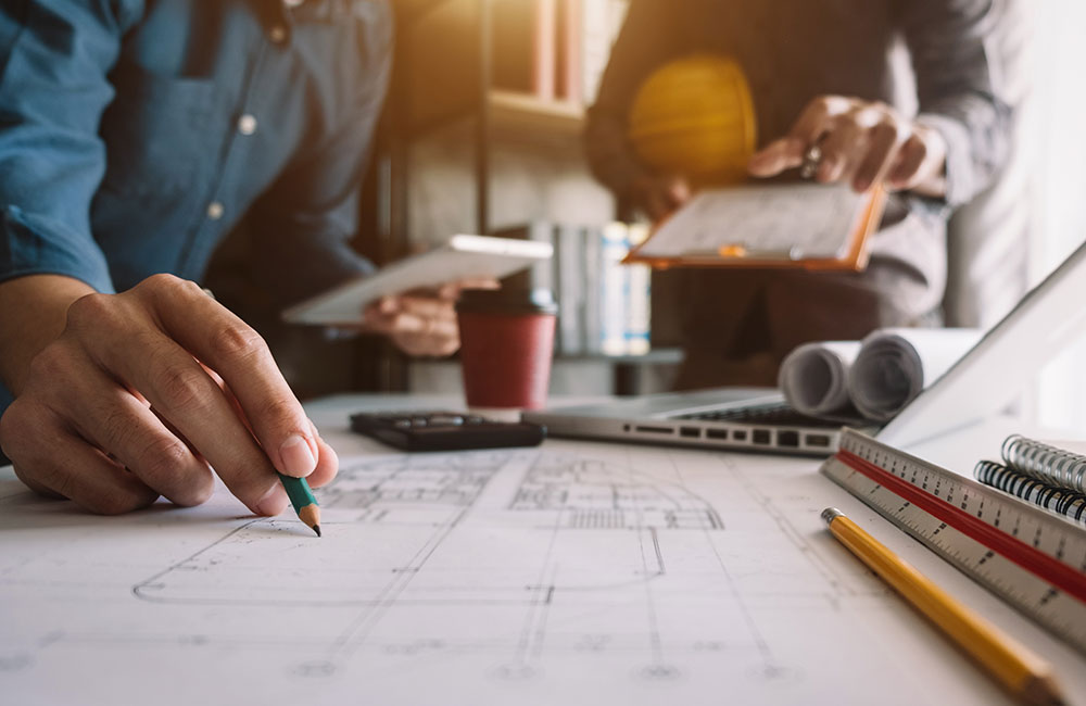Photo of a person working on engineering plans