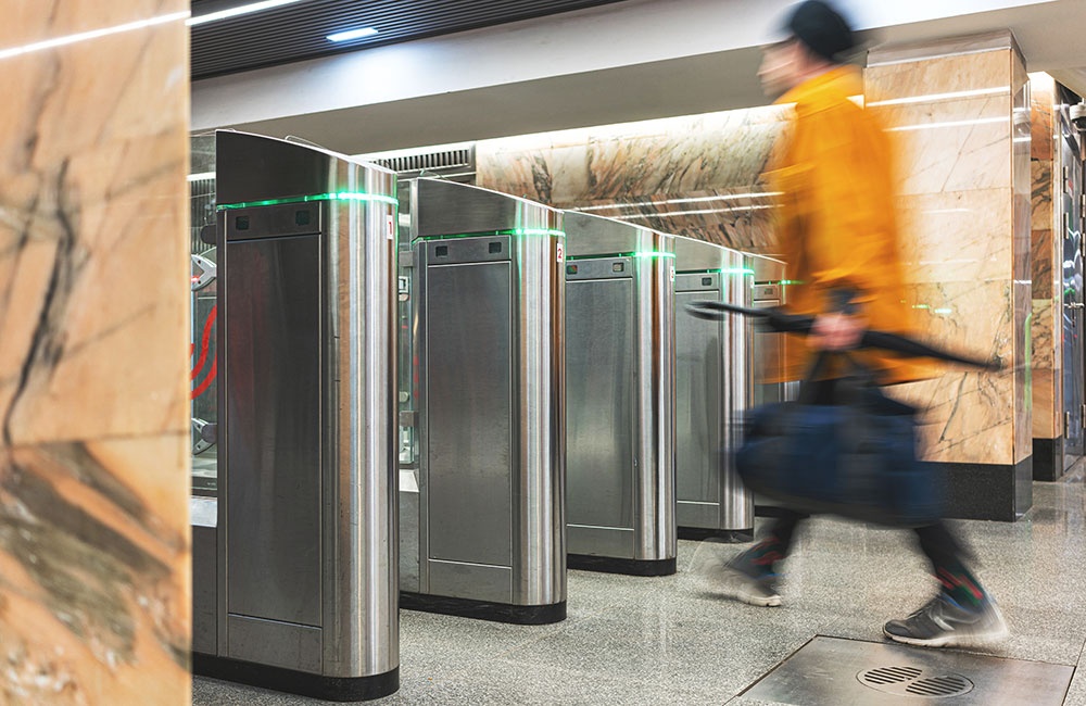 Person using a coin operated turnstile