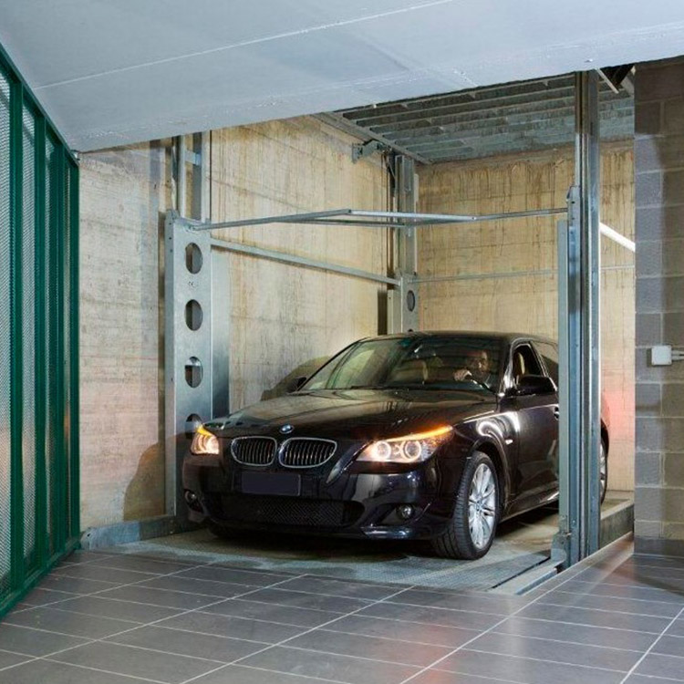 BMW 5 Series at the bottom level of an underground car lift