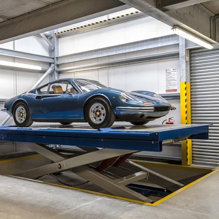 Ferrari Dino on a heavy duty rising car lift