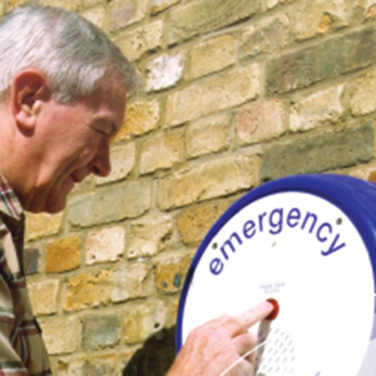 Man using emergency intercom point