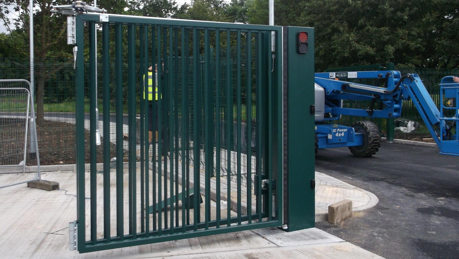 Automatic bifolding gates