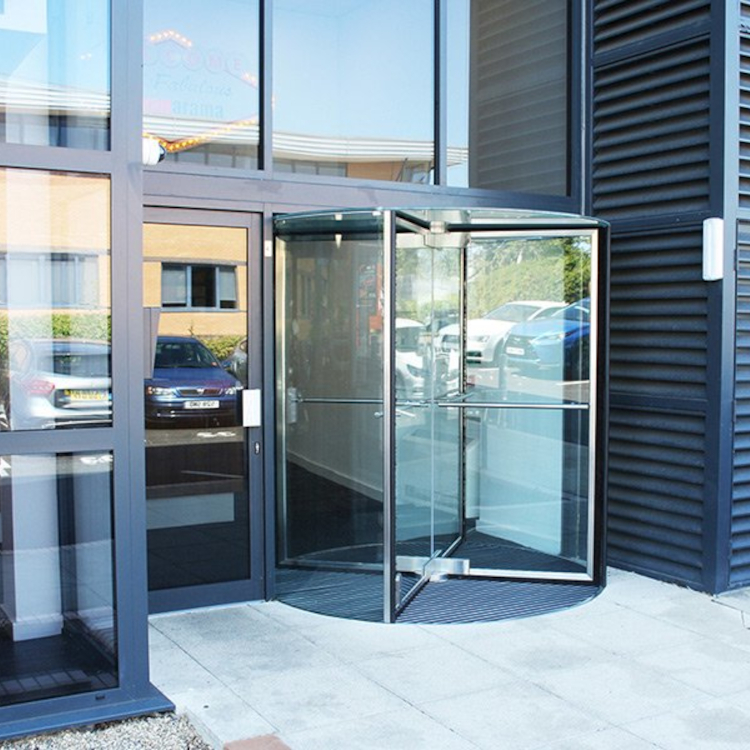 Photo of frameless glass revolving door