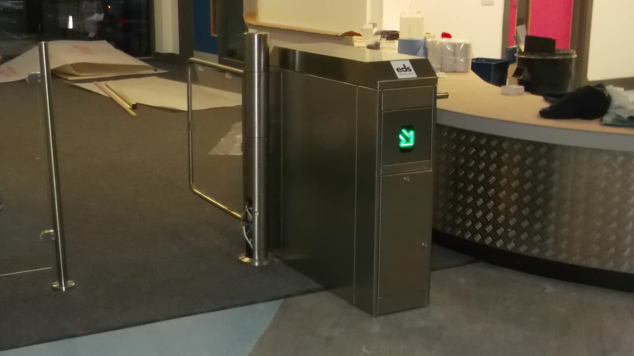Glass coin operated gate with turnstile