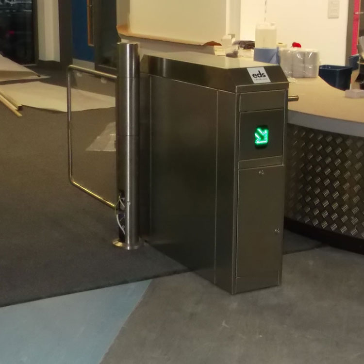Coin oeprated turnstile with directional arrow