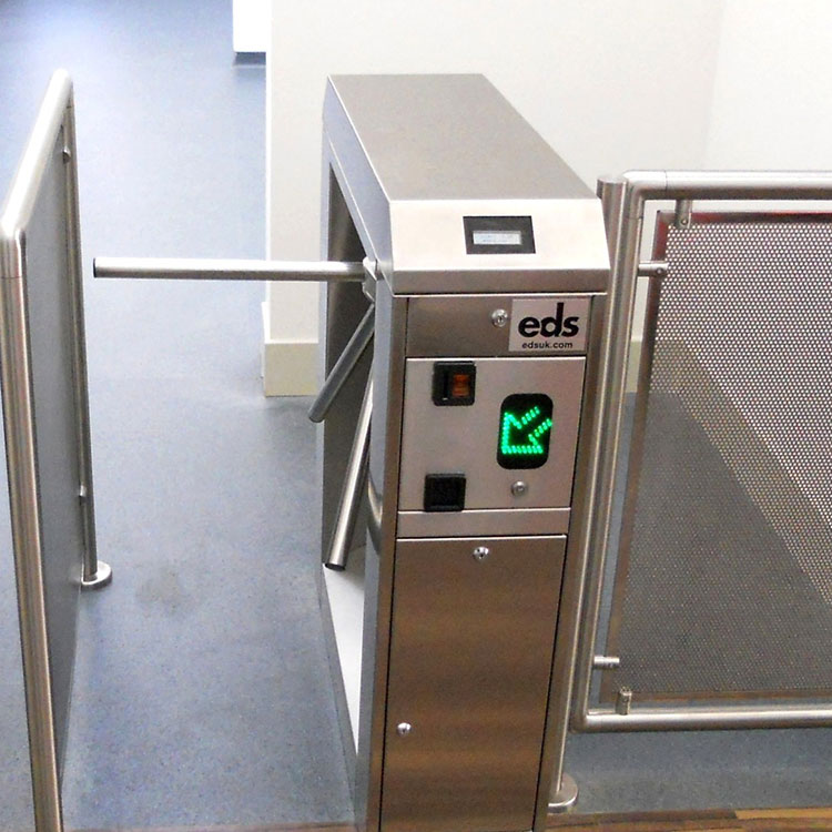 Coin operated turnstile with directional arrow