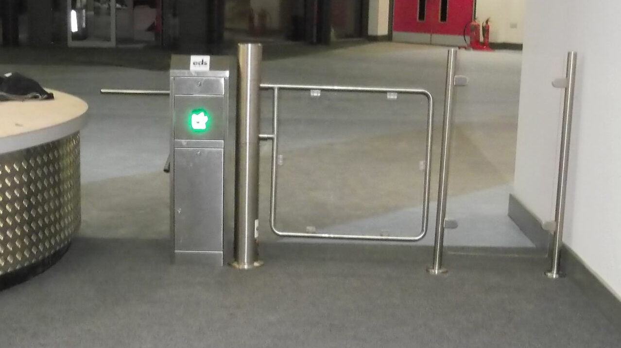 Half height turnstile with wide glass disabled access gate