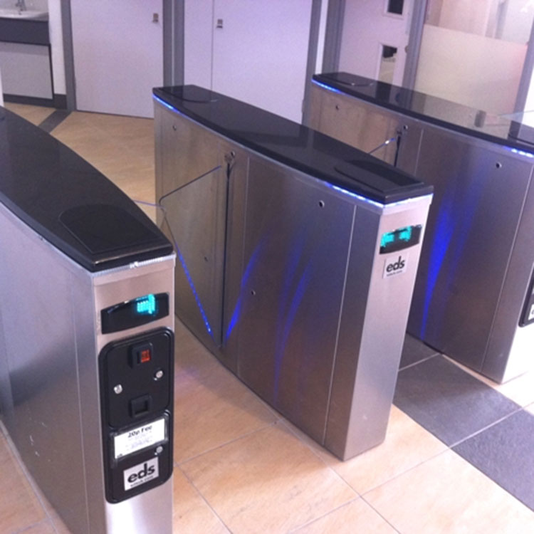 Coin operated turnstiles with directional arrows