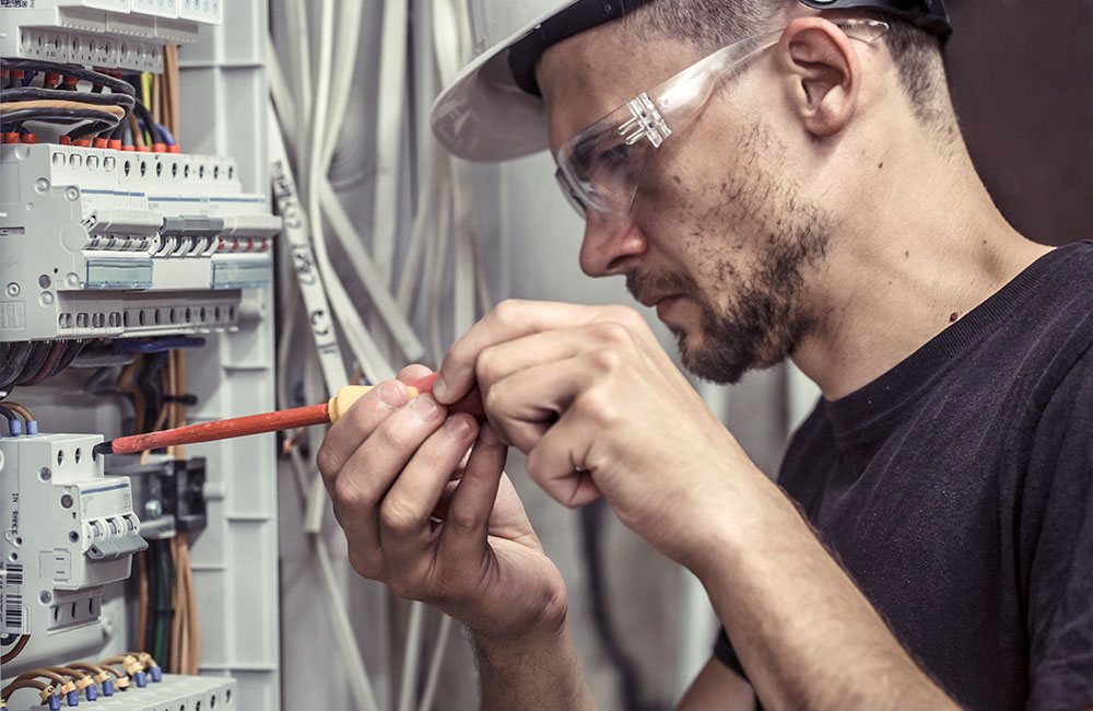 Photo of an electrician carrying out repairs