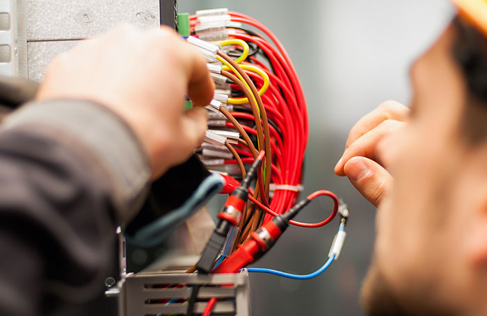 Electrician installing wiring
