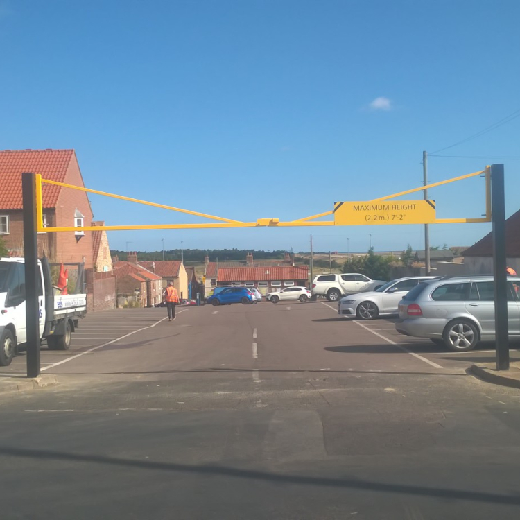 Double leaf height restriction barrier in car park