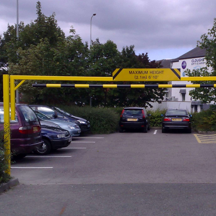 Height restriction barrier at entrance to car park