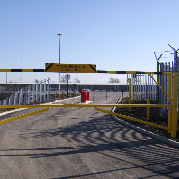 Combined height restriction barrier and swing access gate