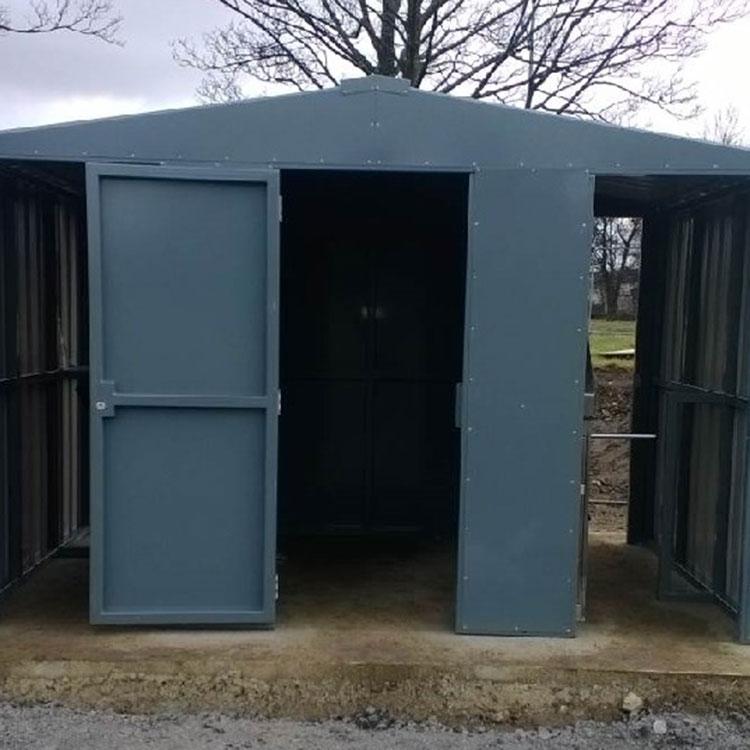 Half height turnstiles enclosed under canopy