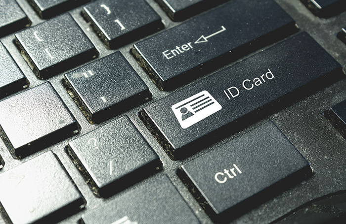 """Close-up image of a keyboard with """"ID Card"""" button"""