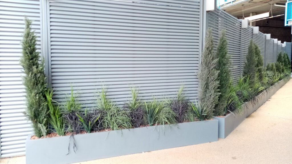 Louvered fence wall with planters