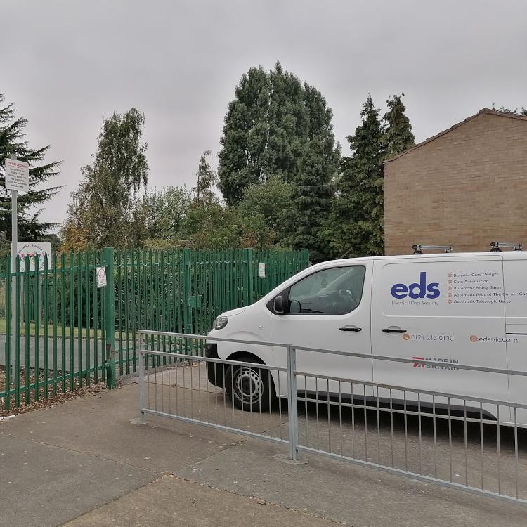 Photo of EDS van outside automatic sliding gate at Shirestone Academy