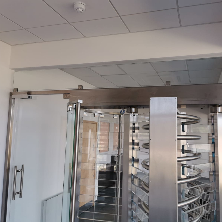 Full height glass turnstile gates