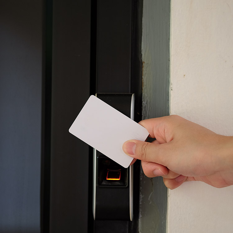 Person using an RFID card to enter a building