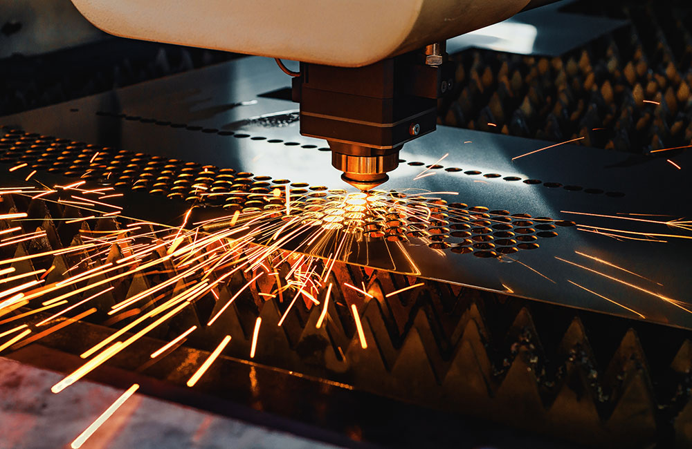 Photo of a CNC machine working on an ornate design