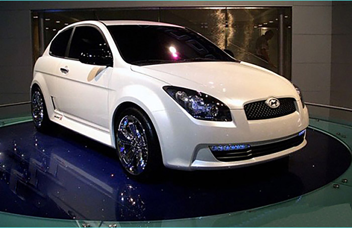 Hyundai on a rotating car turntable with a glass top in a showroom