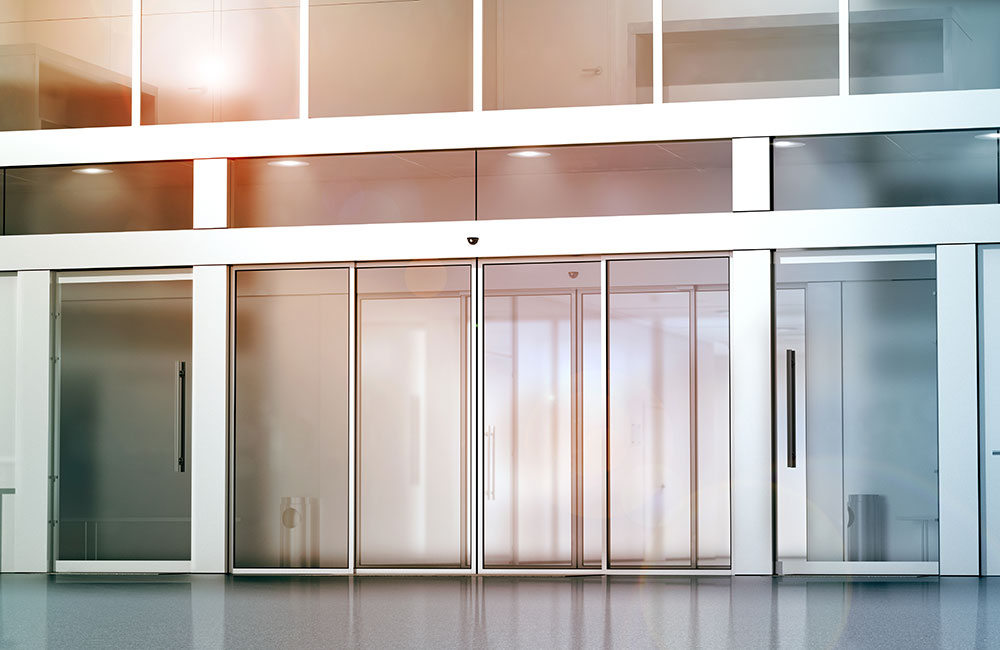 Photo of automatic glass sliding doors in an office building