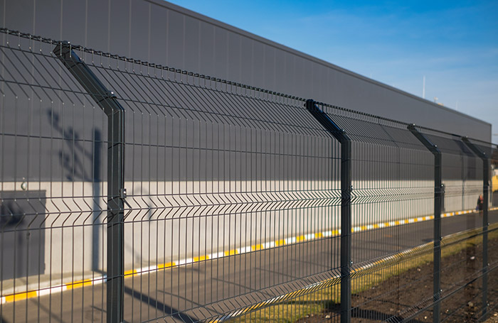 Photo of a tall security fence
