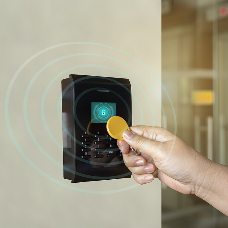 Person using an RFID tag to gain entry to a secure room