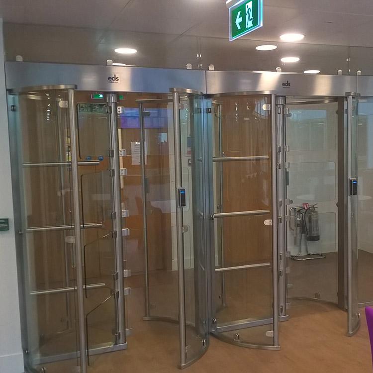 Full height glass turnstiles installed in QA Training's office