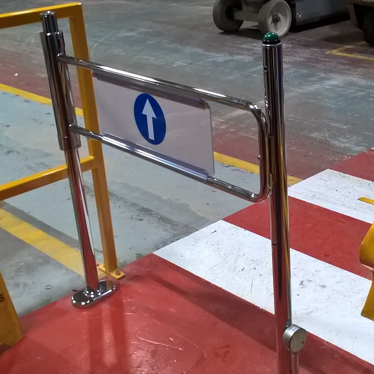 Close up photo of EDSUKBAP8 supermarket style pedestrian gate in Armacell Manufacturing's warehouse