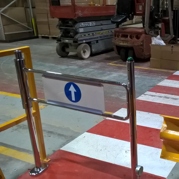Photo of EDSUKBAP8 supermarket style pedestrian barrier gate in Armacell Manufacturing warehouse