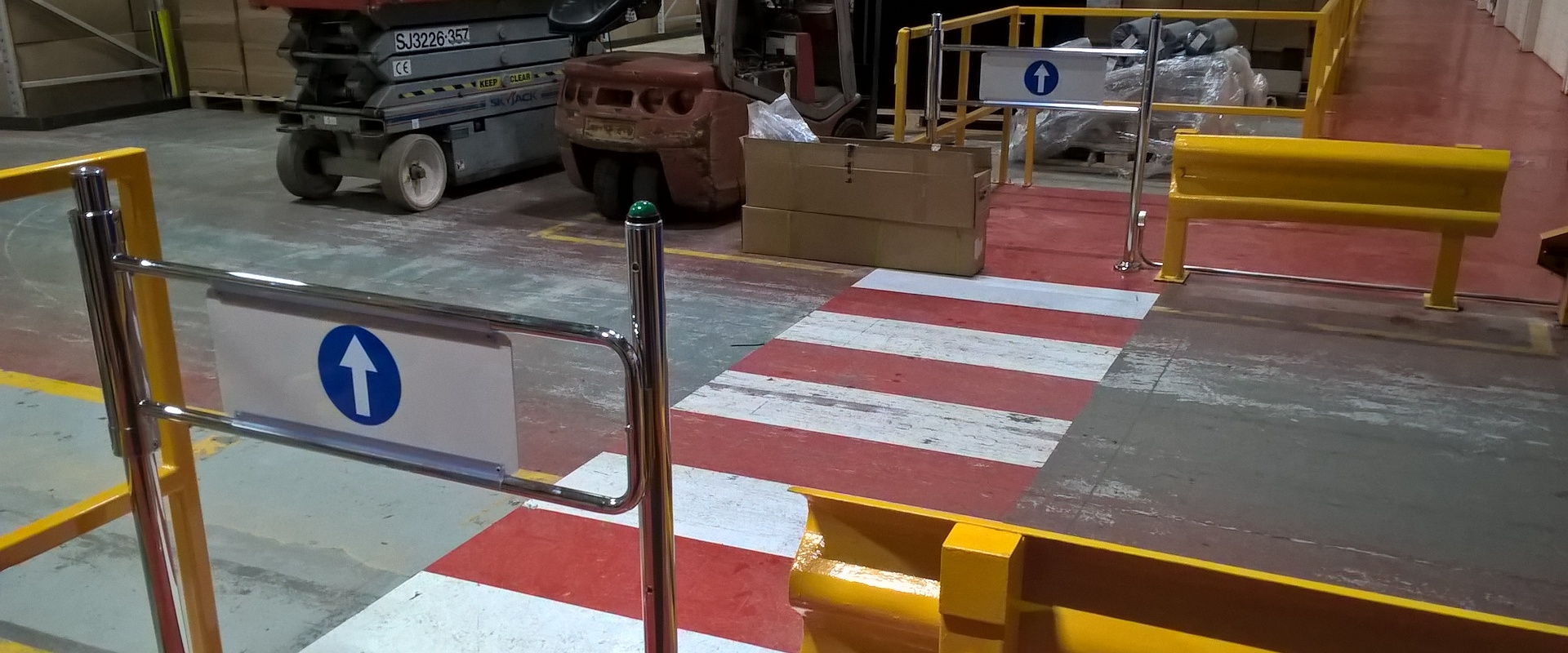 Photo of locking pedestrian safety gates in Armacell Manufacturing's warehouse