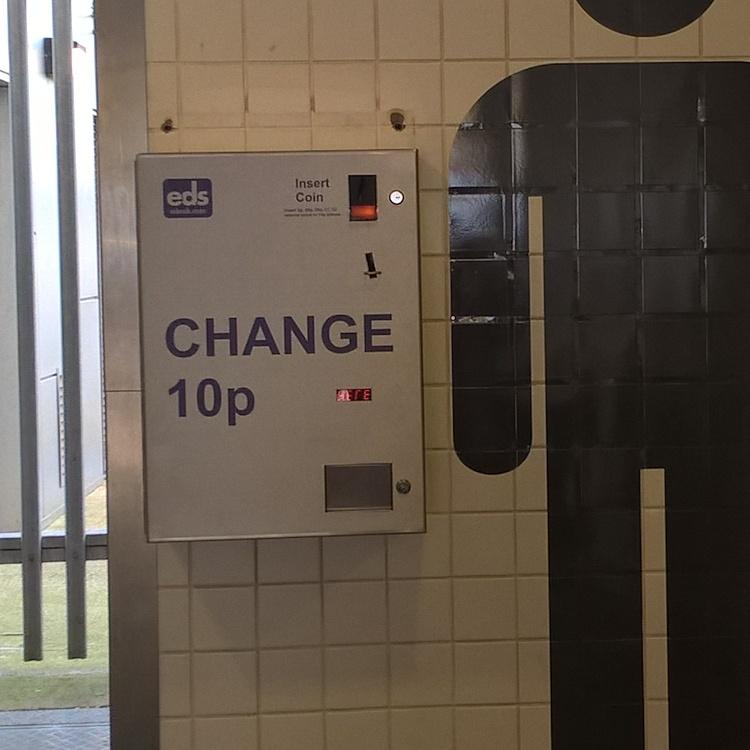 Photo of wall mounted change machine