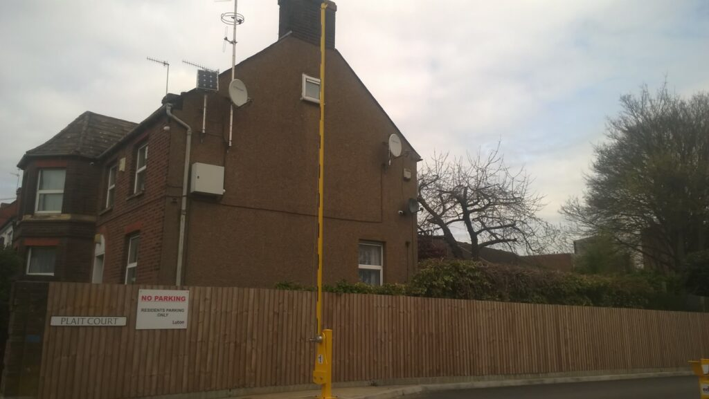 EDS manual barrier arm raised to allow entrance to a residential estate